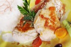 Chicken steak with garnish Stock Images