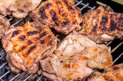 Chicken steak on the grill. Cooking chicken on the barbeque with charcoal in garden royalty free stock images