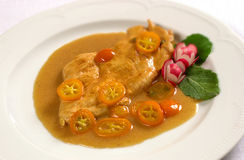 Chicken steak with kumquat f Royalty Free Stock Image