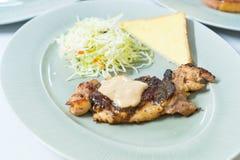 Chicken steak on plate Stock Photography