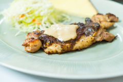 Chicken steak on plate Royalty Free Stock Images