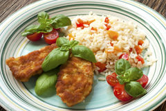 Chicken steak with rice and vegetables Stock Photo