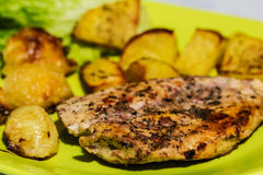 Chicken steak with roasted onions and potatoes Royalty Free Stock Images