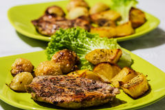 Chicken steak with roasted onions and potatoes Royalty Free Stock Photos
