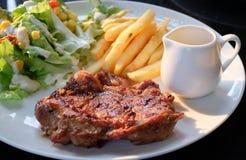 Chicken steak with salad Stock Photos
