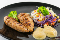 Chicken steak with salad Stock Photography