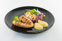 Chicken steak with salad Royalty Free Stock Photo