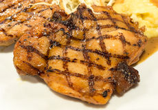 Chicken steak with a in selective focus. Chicken steak served with mashed potatoes on a plate Royalty Free Stock Photos