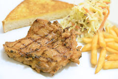 Chicken steak served with french fries ,salads and bread Royalty Free Stock Photography