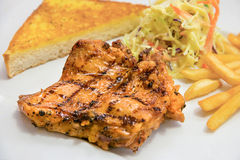 Chicken steak served with french fries, salads and bread Royalty Free Stock Images