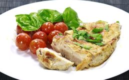Chicken steak with a tomato salad Royalty Free Stock Photography