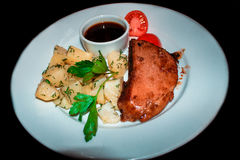 Chicken steak with tomatoes and herbs with potatoes Stock Photography
