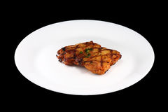 Chicken steak. On a white dish royalty free stock photography
