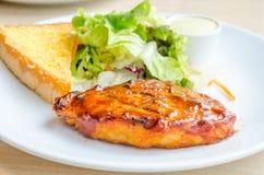 Chicken steak on white dish Stock Photography