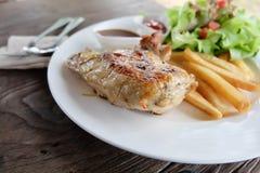 Chicken steak on white dish. Stock Photography