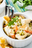 Chicken stew with carrot and green peas in a sauce Royalty Free Stock Photos
