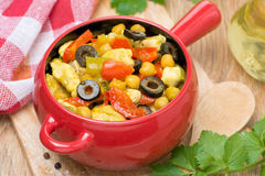 Chicken stew with chickpeas and vegetables in the pot, top view Stock Photos