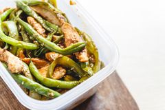Chicken stew and green beans in plastic ovens for cold storage or freezing.  stock image