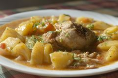 Chicken stew with potatoes. Bulgarian kitchen: chicken stew with potatoes and carrot Royalty Free Stock Images
