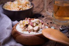 Chicken stew with rice, Sauerkraut and beer on rustic wooden desk Stock Image
