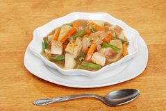 Chicken stew with a spoon stock photography