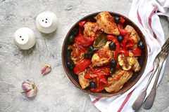 Chicken stewed in tomato sauce with bell pepper,onion and olives Royalty Free Stock Image