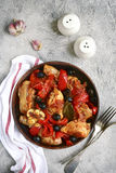Chicken stewed in tomato sauce with bell pepper,onion and olives Royalty Free Stock Photography
