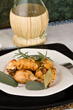 Chicken, stewed in tomato, wine and herb sauce. A typical recipe from Tuscany (Italy Royalty Free Stock Photos
