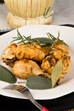 Chicken, stewed in tomato, wine and herb sauce Stock Photos