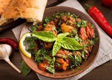 Chicken stewed with tomatoes and herbs Stock Image