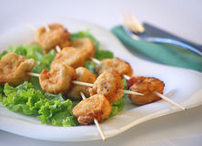 Chicken sticks. A white plate with fried chicken sticks Stock Photos