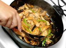 Chicken stir-fry cooking Stock Photos