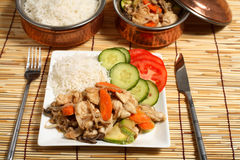 Chicken stir-fry dinner table Royalty Free Stock Images