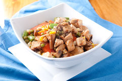 Chicken stir fry and farm fresh vegetables Stock Photos
