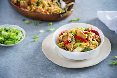 Chicken stir fry with peppers, sprouts, bok choy. Chicken stir fry with bell peppers, bean sprouts and bok choy in a bowl. Chicken kung pao with vegetables Royalty Free Stock Image