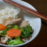 Chicken stir-fry  served in white bowl with rice chinese style Stock Photos