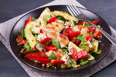 Chicken, strawberry, avocado and spinach salad with almonds. Royalty Free Stock Photo