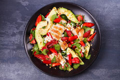 Chicken, strawberry, avocado and spinach salad with almonds. Royalty Free Stock Photography