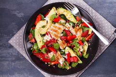 Chicken, strawberry, avocado and spinach salad with almonds. Royalty Free Stock Image