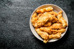 Chicken strips in bowl stock photography