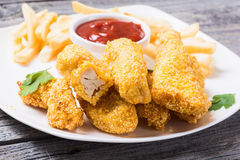 Chicken strips and French fries Royalty Free Stock Images
