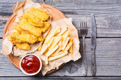 Chicken strips and French fries Stock Photo