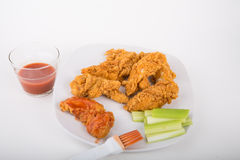 Chicken Strips with Hot Sauce and Celery Strips Stock Photography