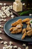 Chicken strips in popcorn breadcrumbs Stock Images