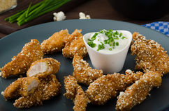 Chicken strips in popcorn breadcrumbs. With delicious garlic dip and panini toast Royalty Free Stock Photography