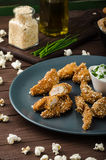 Chicken strips in popcorn breadcrumbs Royalty Free Stock Photo