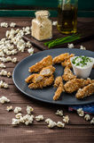 Chicken strips in popcorn breadcrumbs Royalty Free Stock Images