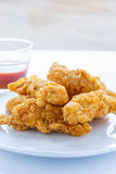 Chicken Strips on White Plate with Hot Sauce Stock Images