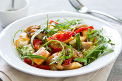 Chicken with sundried tomato and rocket salad Royalty Free Stock Images