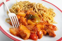 Chicken sweet and sour with fork Stock Image